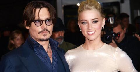 El actor Johnny Depp y su pareja Amber Heard. REUTERS