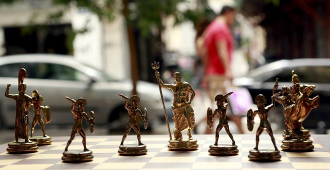 Chess pieces depicting Greek gods and Spartan soldiers on display in a shop in Athens, Greece July 11, 2015. Skeptical European finance ministers gathered on Saturday to decide whether to negotiate a third bailout for Greece after Prime Minister Alexis Ts