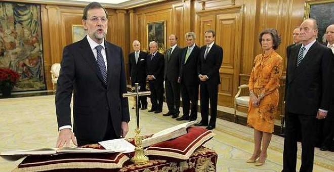 Rajoy en el momento de su toma de posesión como presidente del Gobierno.- EFE
