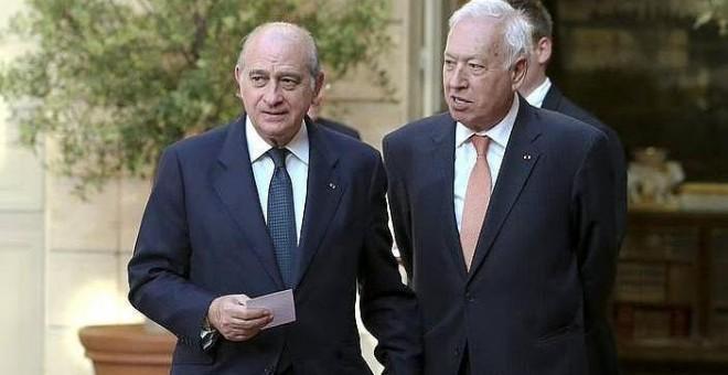 Los ministros del Interior, Jorge Fernández Díaz, y de Exteriores y de Cooperación.- EFE
