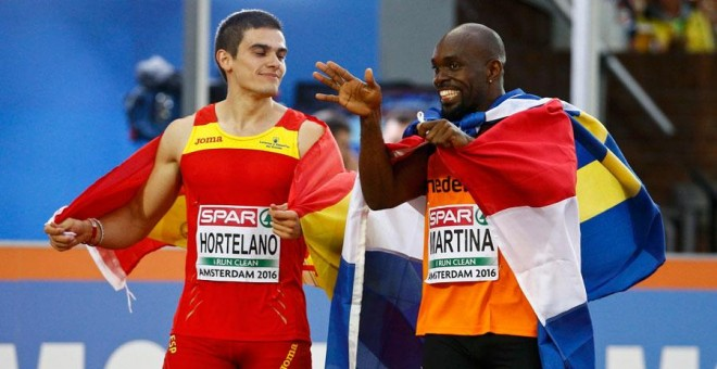 Bruno Hortelano y Churandy Martina, tras la final. REUTERS/Michael Kooren