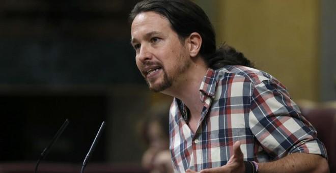 El lider de Podemos, Pablo Iglesias, durante su intervención en la sesión del debate de su investidura. - EFE