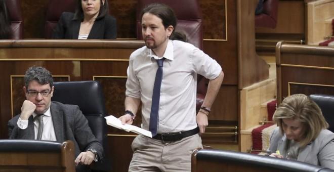 El líder de Podemos, Pablo Iglesias, antes de su intervención ante el pleno del Congreso donde el presidente del Gobierno, Mariano Rajoy, expone las conclusiones del último Consejo Europeo EFE/Chema Moya