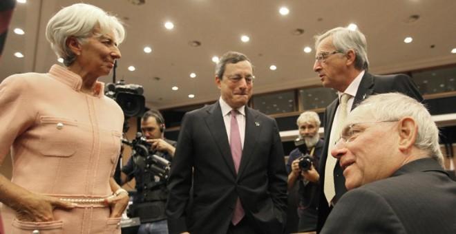 Christine Lagarde, Mario Draghi y Jean-Claude Juncker en una reunión informal del Eurogrupo en Nicosia (Chipre). AFP/ Yiannis Kourtoglou