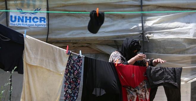 Una mujer siria en un campamento de refugiados en la ciudad de Zahrani, al sur de Líbano. - REUTERS