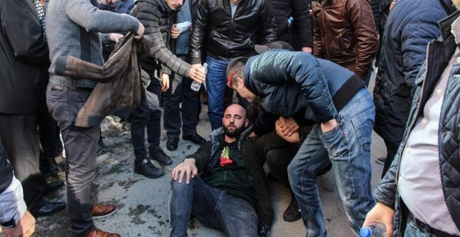 An injured protester is helped by others as supporters of Albanian opposition shout anti Government slogans during a protest in front of the government building in Tirana, Albania, 16 February 2019. Reports state that they are demanding the resignation of