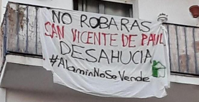 Pancarta en una casa criticando a la SSVP / Guillermo Martínez