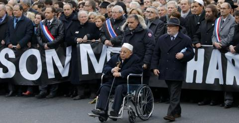 Paris Mosque rector Dalil Boubakeur (C), French political, religious and personalites take part in a solidarity march (Marche Republicaine) in the streets of Paris January 11, 2015. Hundreds of thousands of French citizens will be joined by dozens of fore