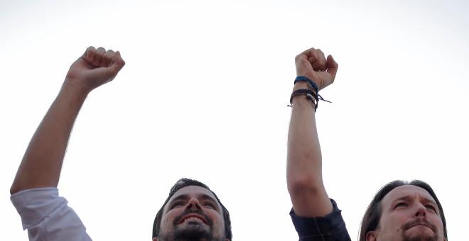Alberto Garzón y Pablo Iglesias, en el mitin de este jueves. REUTERS