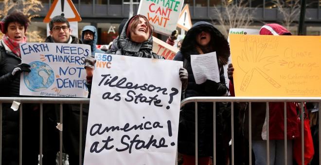 Manifestantes se reúnen en EEUU para protestar por las ideas de cambio climático de Trump/ REUTERS