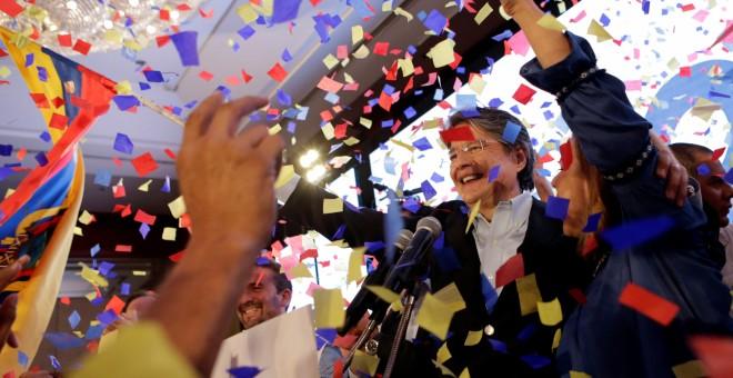 Guillermo Lasso celebra su segunda posición en las elecciones. - REUTERS