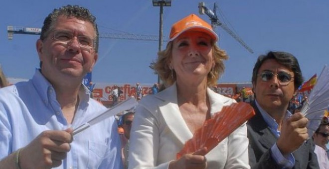 Francisco Granados e Ignacio González, ambos actualmente en prisión, junto a Esperanza Aguirre en un acto del Partido Popular en Madrid.