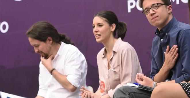 Pablo Iglesias, Irene Montero, e Íñigo Errejón, durante el acto 'Madrid se levanta'. EFE/Fernando Villar