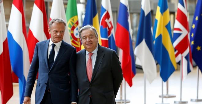 El presidente del Consejo Europeo, Donald Tusk, junto al secretario general de la ONU, Antonio Guterres. /REUTERS