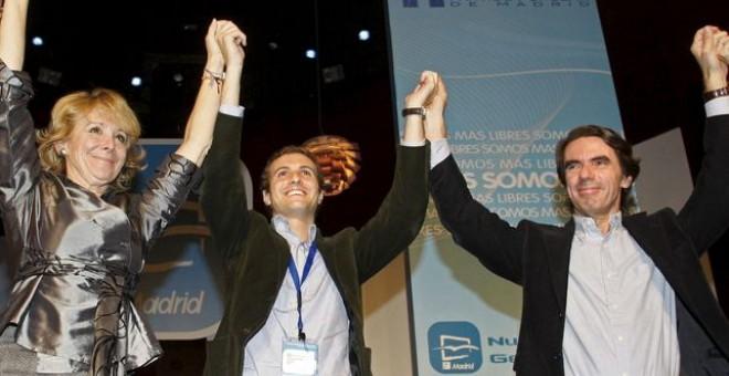 Esperanza Aguirre, Pablo Casado y José María Aznar, en el Congreso de las Nuevas Generaciones del PP, celebrado en la localidad madrileña de Las Rozas en 2008. EFE