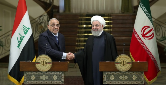 Iranian President Hassan Rouhani shake hands with Iraq's Prime Minister Adel Abdul Mahdi during a news conference in Tehran
