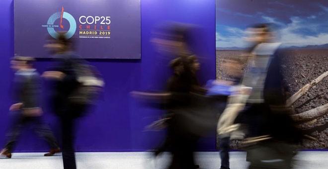 Asistentes a la cumbre del clima COP25 en Madrid. / JUAN CARLOS HIDALGO (EFE)