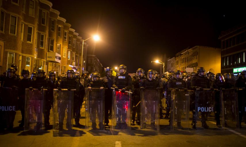 Police line up shortly before the deadline for a city-wide curfew passed in Baltimore. REUTERS/Eric Thayer