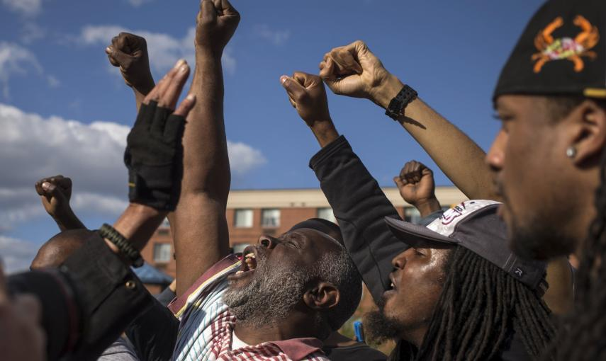 "Men shout ""Freddie G"" as they protest against the death of 25-year-old black man Freddie Gray who died in police custody in Baltimore. REUTERS/Adrees Latif"