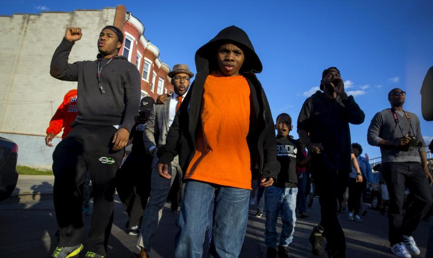 People march near North Ave and Pennsylvania Ave in Baltimore. REUTERS/Eric Thayer