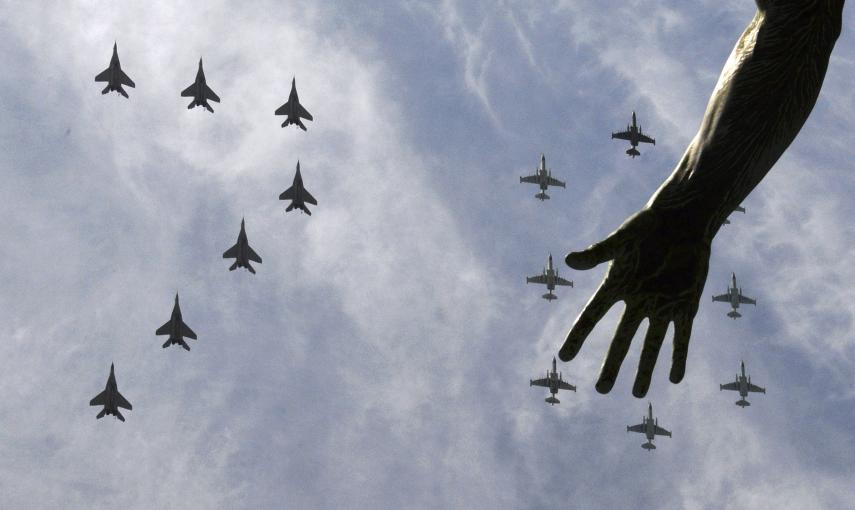 MiG-29 and Su-25 military jets fly in formation above Red Square during the Victory Day parade in Moscow. REUTERS/Host Photo Agency/RIA Novosti
