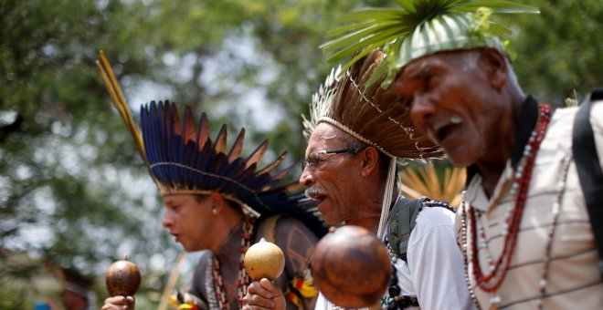 FILE PHOTO: Indigenous people from various tribes dance as they wait to deliver a letter to Brazil's President-elect Jair Bolsonaro at a transitional government building in Brasilia, Brazil, December 6, 2018. REUTERS/Adriano Machado/File Photo