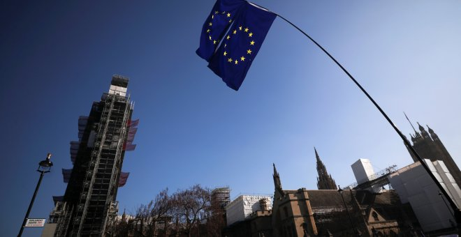 EU flags are seen outside of the Houses of Parliament in London