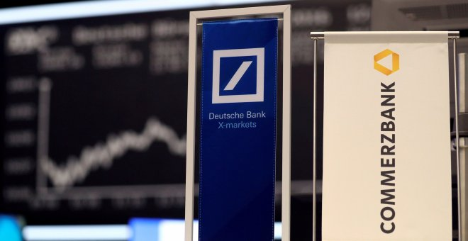 Banners of Deutsche Bank and Commerzbank are pictured in front of the German share price index, DAX board, at the stock exchange in Frankfurt, Germany, September 30, 2016. REUTERS/Kai Pfaffenbach/File Photo