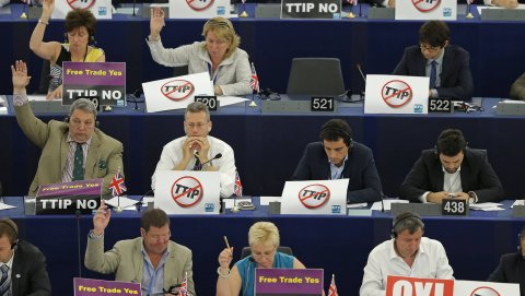 "Members of the European Parliament with posters on the desks which read ""no TTIP"" take part in a voting session at the European Parliament in Strasbourg, France, July 7, 2015. The European parliament will vote on Wednesday on the E.U.-U.S. Transatlantic T"